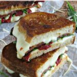 Sun dried tomatoes, arugula, mozzarella and Parmesan cheese make this BLT recipe so much more than the ones that you grab at your local sandwich shop!