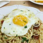 Breakfast pasta is becoming more popular and this recipe can be made with ham or bacon. The runny yolk acts as a sauce for the pasta and is so yummy!