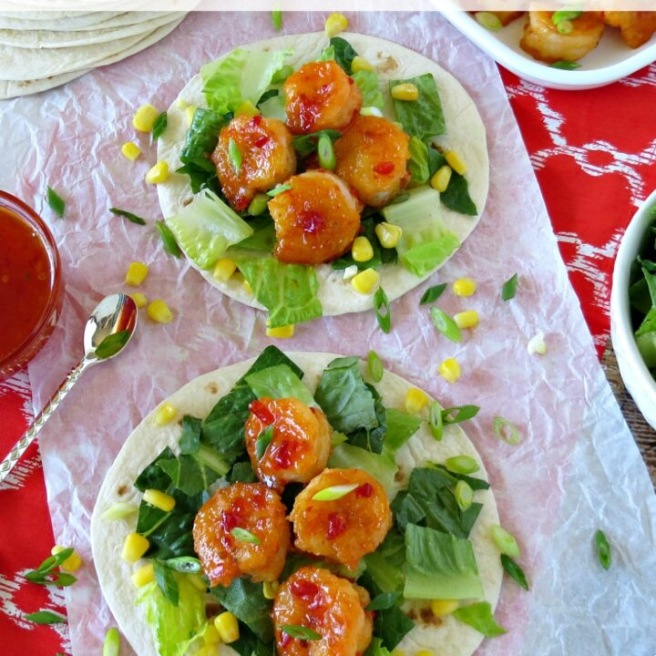 I love shrimp tacos and these are just delicious. With just a little bit of crunch and a lot of flavor, these sweet & spicy shrimp tacos are sure to please
